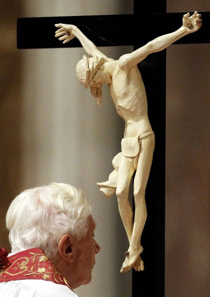 Pope Benedict XVI holds the Crucifix as he leads the Passion of the Christ Ceremony in Saint Peter's Basilica at the Vatican